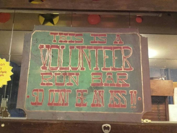 """Sign saying """"This is a volunteer run bas. Don't be an ass!"""""""